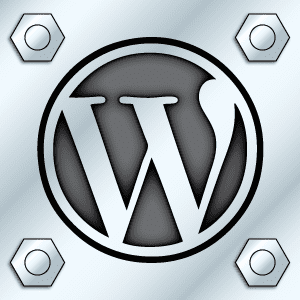 WordPress logo as if it were etched into steel - graphic design by Frank's Designs Empowered Marketing